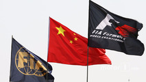 FIA, China, and F1 flags