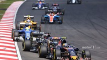 Carlos Sainz Jr., Scuderia Toro Rosso STR11 leads Fernando Alonso, McLaren MP4-31