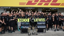 Nico Rosberg, Mercedes AMG F1 and team mate Lewis Hamilton, Mercedes AMG F1 celebrate the Constructors title