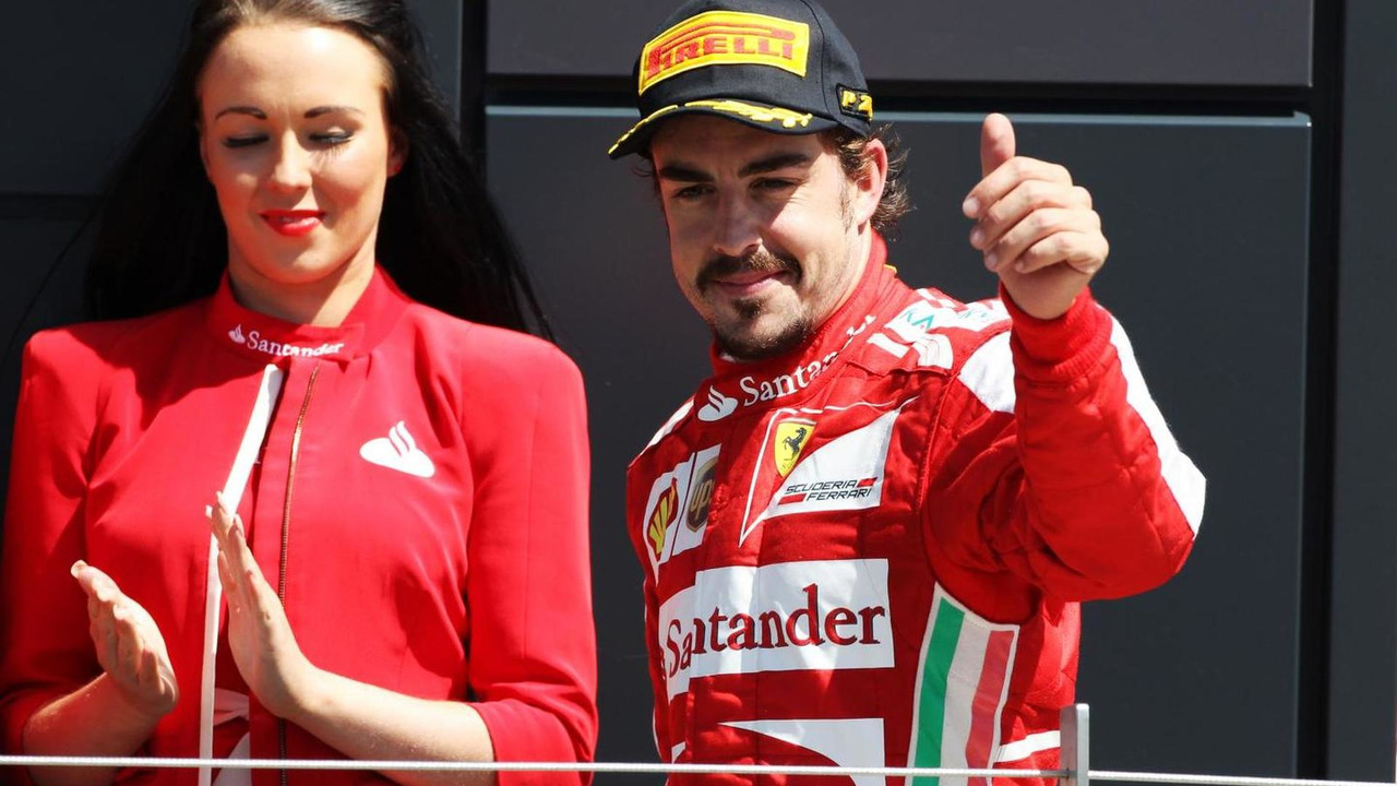 Fernando Alonso (ESP) Ferrari celebrates his third position. 2013 British Grand Prix
