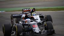 Fernando Alonso, McLaren MP4-31 and Sergio Perez, Sahara Force India F1 VJM09