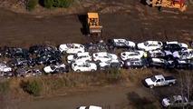 BMWs wrecked in train crash