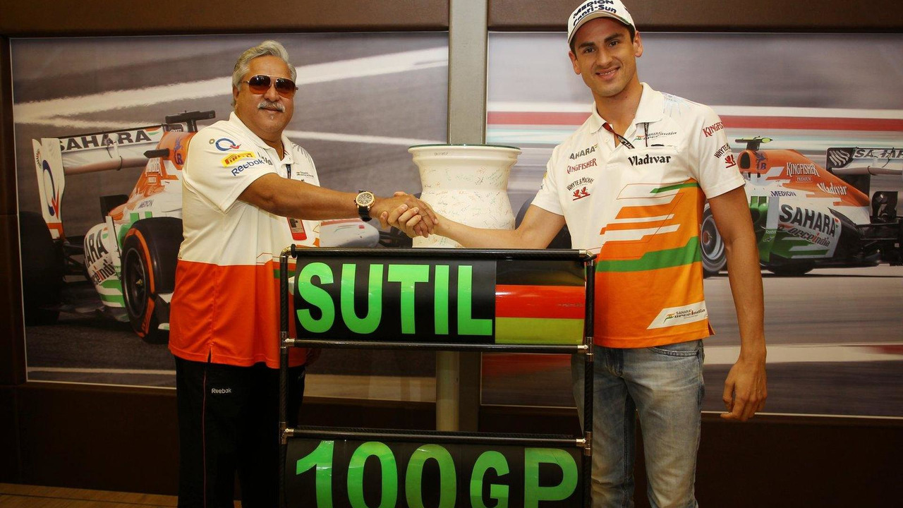 Vijay Mallya presents ceramic wheel rim signed by the team to Adrian Sutil who is celebrating his 100th GP 28.07.2013 Hungarian Grand Prix