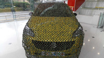 2015 Vauxhall Corsa with camouflage net